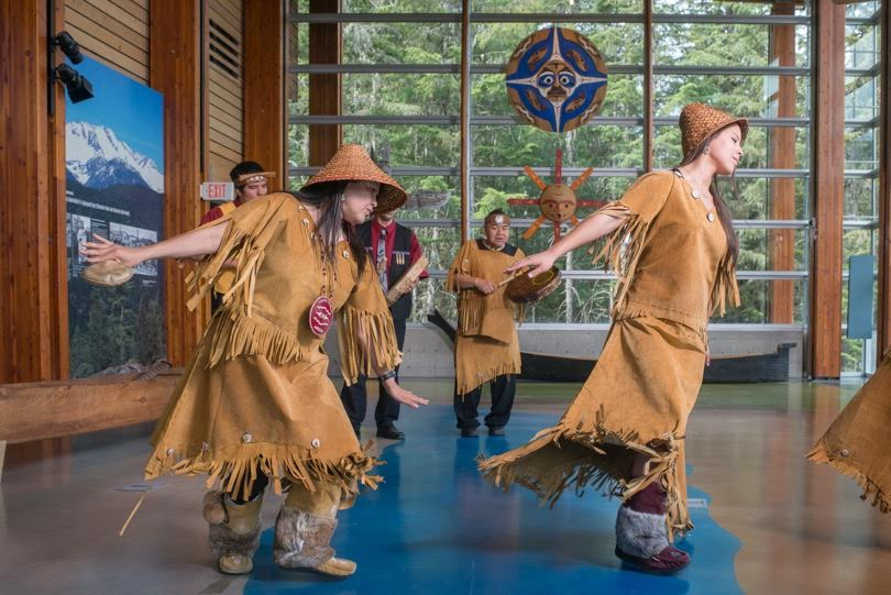 First Nations performers dancing at the Squamish Lil'wat Cultural Centre