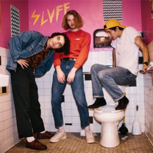 album cover for Naked Giants' SLUFF showing three men standing in a bathroom.