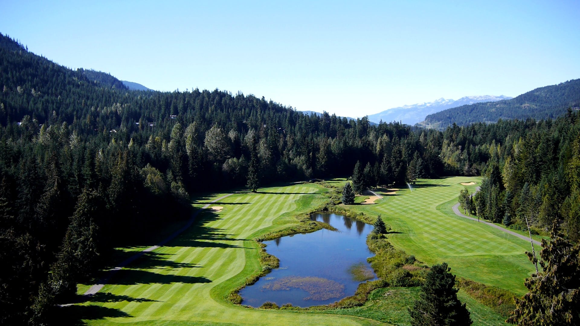 Decorative image of Whistler golf course, surrounded by mountains
