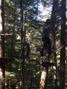 Two young people from the Urban Native Youth Association tackle the tree-ropes course at TAG. They came to Whistler last year as part of our Adventure Sessions program and loved it.