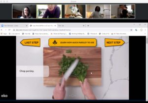 screen capture of a zoom call. the Zero Ceiling staff and participants are watching a video tutorial on how to chop parsley during one of our virtual family dinners at the start of the COVID-19 pandemic.